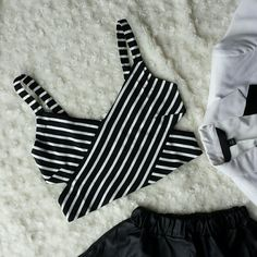 """Striped bralette /crop top Black and white. Polyester / rayon / spandex.  The medium fits a 36D bust well. Stretch. Brand new without tags.   1 medium  2 large  Medium: 15"""" bust flat lay  Large: 16"""" bust flat lay Tops Crop Tops"""