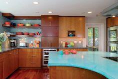 Aqua concrete counter top? Cool.  love the blue tile back-splash and open shelving.