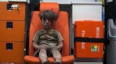 Omran, a four-year-old Syrian boy covered in dust and blood, was pictured in an ambulance ...