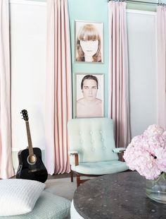 Pastel fabric-swathed walls with framed portraits by artist Sarah Dorio.