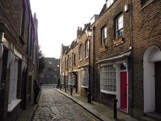 Little Green Street - in Kentish Town is one of a handful of Georgian Streets to survive in London. Many were cleared during the Victorian Era, and those remaining were bomb damaged in WW2. NW5, Tufnell Park Tube. By BrotherMagneto on Flickr, 2009.