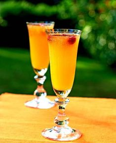 Mango Bellini    -makes 1 drink.    1 part mango juice  2 parts chilled Champagne or sparkling wine  3 whole raspberries  Fill a champagne flute one-third full with mango nectar. Top with sparkling wine, leaving a little room for the raspberries, and stir gently. Place raspberries in champagne flute. Enjoy!