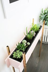 Skinny Planter Stand DIY (A Beautiful Mess) You can call it a coping mechanism, but the colder it gets in winter, the more plants I add to my house. Adding tropical or desert plants into my space totally tricks my brain into thinking warm and h Plant Box, Diy Plant Stand, Plant Stands, Plant Table, Diy Planter Box, Diy Planters, Backyard Planters, Patio Plants, Succulent Planters
