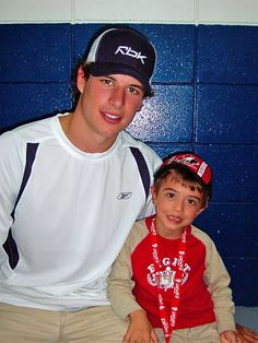 Sidney Crosby with a fan. Lucky boy I want to meet sidney