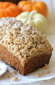 Crumbly Pumpkin Bread - With lightened-up options of using whole wheat pastry flour, coconut oil and applesauce, this crumbly bread can be eaten guilt-free with your morning cup of coffee!