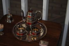 Gustav Gaudernack for David Andersen. Gilt silver guilloche red enamel coffee set on matching tray. 1895-1900