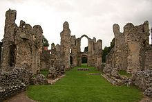 The 12th-century ruined church of Castle Acre Priory looking west from the site of the High Altar. The foundations of two transverse screens can be seen. The closer was the pulpitum screen (which was attached to the choir stalls); the further was the rood screen, which had the altar of the Holy Cross attached to its western face.
