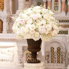 White roses, hydrangea, astilbe, and stock in a classic urn arrangement - perfect for the ceremony altar