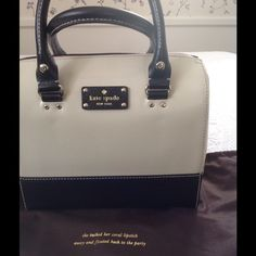 New Kate Spade bag Nwt kate spade bag in black n cream/off white color. Can be worn as a handbag or shoulder bag. Extension handle and dust bag included. Sorry no trade or paypal... Open for reasonable offers. kate spade Bags