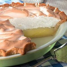 """Sweet waves of meringue cover a tart lemon pie filling. One online reviwer claims, """"This recipe is so easy and turns out a perfect pie. My pies looked just like the photograph! I took two to a family gathering and they recieved rave reviews for looks and taste! I would highly recommend this recipe."""""""