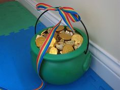 Tie a Rainbow colored ribbon and lead it throughout the house and the end is tied to a pot of goodies