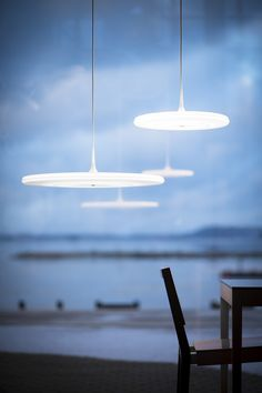 Tip Pendant  combines the latest LED technology and traditional material opal. | Designer Tapio Anttila