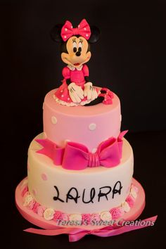 It's pink and ... has a pretty bow!......Polka Dot & Pink Minnie Mouse First Birthday Cake  - Cake by teresasweetcreations