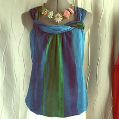 Ann Taylor LOFT Silk Cotton Top Sz S Hiya! Here's a lovely sheer Ann Taylor blue and green silk blend blouse. It's a small and features a feminine neckline detail. It's has a pleated back shoulder for a tailored look. It's in wonderful condition. All my items are steamed and from a smoke/pet free home. Ann Taylor LOFT Tops Blouses