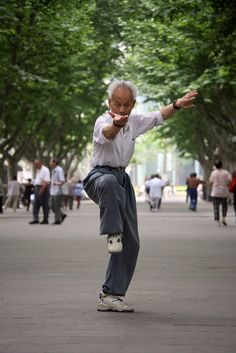 An elderly man gracefully performs Tai Chi movements...a typical early morning exercising in the parks of any city or town throughout China. Mainly participated by the elderly men and women...a chance for a gossip during and after.     Seniors cannot age gracefully if they are not healthy. Daily nutrition is a must if one is to live a long and full life.