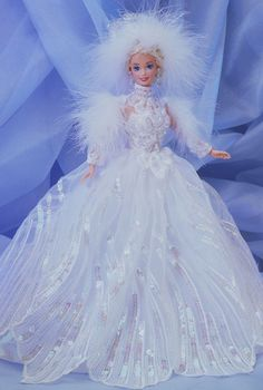 1994 - Snow Princess Barbie® Doll (blonde) | Barbie Collector   Barbie® doll welcomes you to her winter wonderland! Fitted in an elegant white sequined gown with marabou feathers, she exudes the true beauty of a snow-filled day. She's sure to melt your heart!