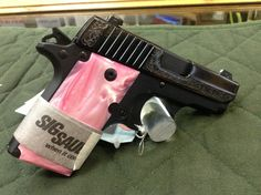 Sig Sauer ok I don't care for pink, but the pink pearl grip with the scroll accents is awesome! Sig Sauer P238, Sig Sg 550, Pink Guns, Toys For Girls, Girl Toys, Trending Christmas Gifts, Pink Ladies, Ladies Club, Cool Guns