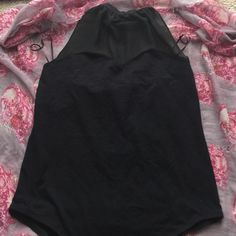 Backless halter top bodysuit The body suit is halter top with a sweetheart design also has a sheer part as shown in the picture. Completely backless, very stretchy and comfortable. 3x but can fit both 2x and 3x Forever 21 Tops Crop Tops