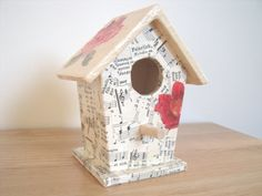 Hey, I found this really awesome Etsy listing at http://www.etsy.com/listing/117860347/decoupage-bird-house-with-vintage-german
