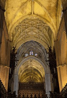 Seville Cathedral, Spain. Christian & Gothic interior with vaulted ceiling and pointed archways, both common featured in this design period. early 12th century