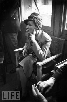 Dressed in a U.S. Army Air Force uniform, Dietrich waits to entertain American troops in France on June 10, 1944, four days after the Normandy invasion.