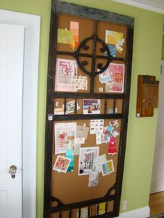 Wooden screen door backed with corkboard to hold pictures and ideas.