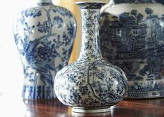 <p>This long-necked vase in a dramatic depiction of hand-painted blue and white florals is an export ware inspired piece with true sophistication. While not for use with real flowers, this decorative