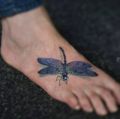 Beautiful dragonfly tattoo on foot by Catalin Druga