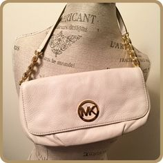 """Michael Kors Handbag Authentic Michael Kors genuine leather handbag in beautiful creamy vanilla color with golden accents. This is the ideal """"going out"""" bag. Mint condition, absolutely flawless. Used once!  12"""" x 6"""" with a 7 3/5"""" drop. Brilliant gold tone hardware. Two snap close.  No holds trades or PayPal  Price is firm  Michael Kors Bags"""