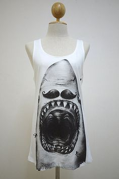 A tank top featuring a very well-groomed shark. | 31 Must-Have Pieces For Your Shark Week Viewing Party