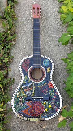 Handcrafted Mosaic Guitar with historical trade beads.