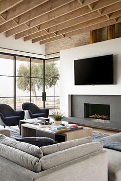 Contemporary living room with bifold window walls