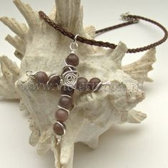 Wire wrapped purple Aventurine gemstone cross on a 45 cm long braided leather necklace.