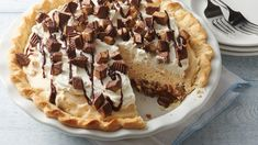 Who doesn't love chocolate   peanut butter? This irresistible pie has a bottom layer of fudge topped with creamy peanut butter filling studded with peanut butter cups.