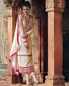 Beige embroidered long suit with golden embroidered patch yoke   1. Beige embroidered georgette suit2. Comes with matching bottom and dupatta3. Can be stitched upto size 42  inches