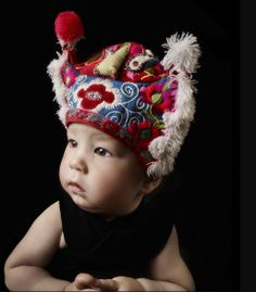 Olaf Blecker for International Wardrobe by Katherina Koppenwallner, authentic Indochinese baby hats