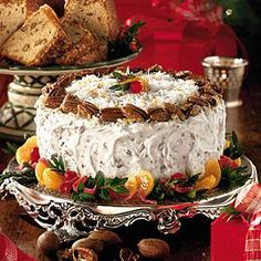 This Italian cream cake recipe is enhanced with a pecan and cream cheese frosting and sweet, tangy orange curd between the cake layers.  Garnish with glazed pecans and a boxwood garland to make it special for the holidays. You'll need to start this cake a day ahead because the Fresh Orange Curd must chill for 8 hours.