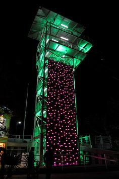 Rock climbing wall with glow in the dark climbing holds.