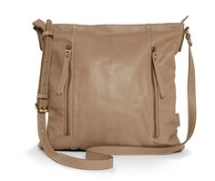 In need of an every day bag. Crafted in soft-natural leather with exterior zipped pocket, the leather cross body allows you to store your every day pretty portables with ease.