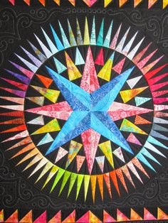 Mariner's Compass star quilt - custom quilting at The Secret Life of Mrs. Meatloaf