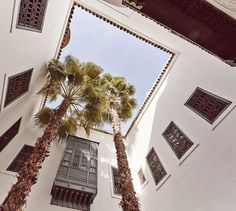 Feel welcome to explore the Berber Deluxe suites in our boutique hotel, with rich textiles and big size photographs of the Morocco Berber culture. Marrakesh, Marrakech Morocco, Looking Up, Palm Trees, Gallery Wall, Hotels, Boutique, Interior Design, Luxury