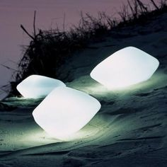 Stones.....I'm ready for a night on the beach now. Love this lighting idea!!