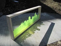 cityscape lasercut onto neon plexi. Hello new presentation idea.: