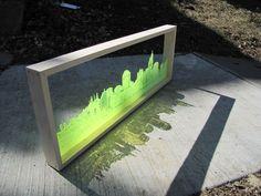 cityscape lasercut onto neon plexi. Hello new presentation idea.: