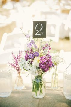 Purple and white wildflower wedding centerpiece