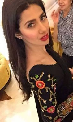 simple black salwaar with embellished sleeves and a red lip