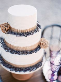 White rustic wedding cake with burlap roses and lavender accents | Organic Lavender Wedding Inspiration via @Bellesbubbles