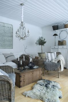 Stylish scandinavian interior featuring sheepskins as rugs and chair covers in the living space. Le Living, Living Room Grey, Home And Living, Living Spaces, Living Area, Living Rooms, Interior Exterior, Interior Design, Deco Addict