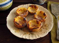 Portuguese Custard Tarts | Food From Portugal. Delicious Portuguese Custard Tarts with excellent presentation, filled with a cream made with corn starch, egg yolk, sugar, milk and cinnamon stick.  http://www.foodfromportugal.com/recipe/portuguese-custard-tarts/