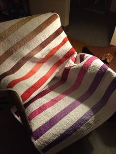 Modern baby girl quilt with hand dyed strips